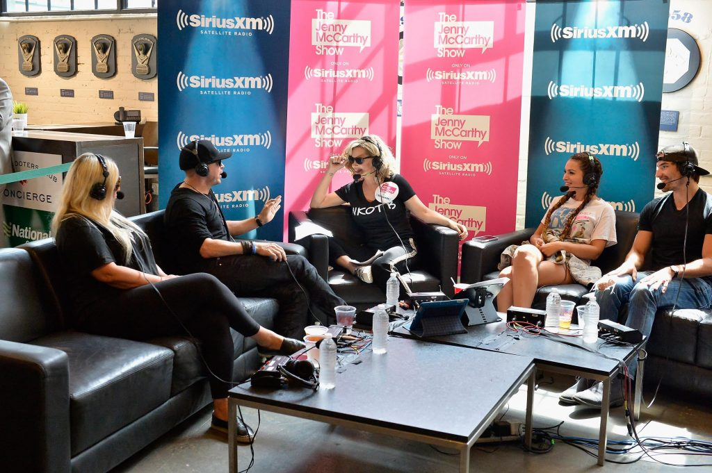 BOSTON, MA - JULY 08:  Colleen Stoetzel, Donnie Wahlberg, Jenny McCarthy, Ashley Iaconetti and Jared Haibon on the set as Jenny McCarthy hosts her SiriusXM Show backstage at Fenway Park in Boston before The New Kids On The Block Sold Out Hometown Concert at Fenway Park on July 8, 2017 in Boston, Massachusetts.  (Photo by Paul Marotta/Getty Images for SiriusXM)